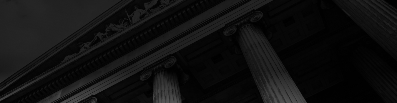 Faded Background image of a courthouse with white pillars and intricate details.